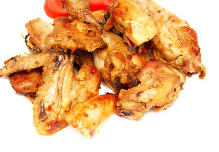 tasty roasted pieces of chicken on white Stock Photo - 9308441