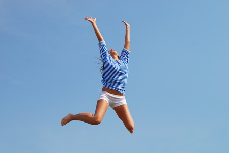 jumping woman against sky background