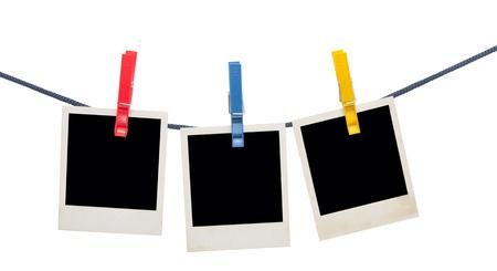 Marcos de fotos en una cuerda aislado en blanco Foto de archivo - 10932630