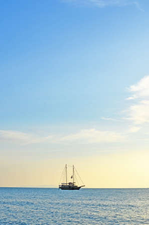 single yacht and blue sea photo
