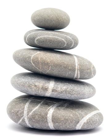 balancing stones isolated on white background