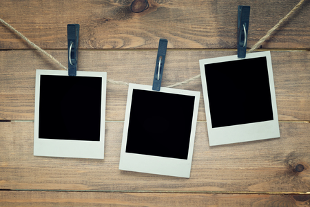 empty photo frames on wooden background photo