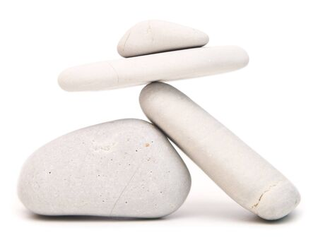 white balancing stones isolated on white background 写真素材
