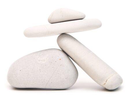 white balancing stones isolated on white background Stock Photo
