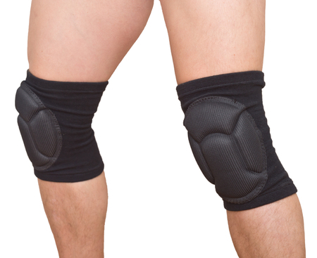 man legs with knee cap pad protector isolated on white background