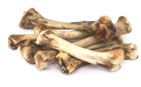 pile of chicken bones isolated on white Фото со стока