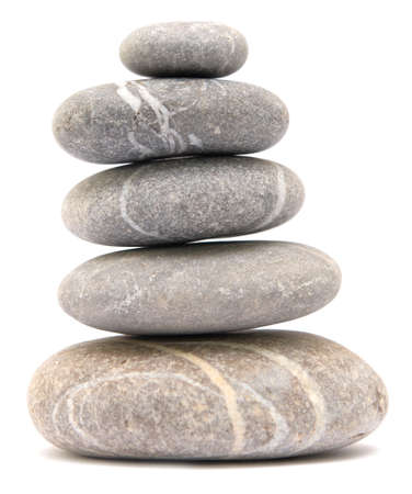 balancing pebble tower isolated on white background
