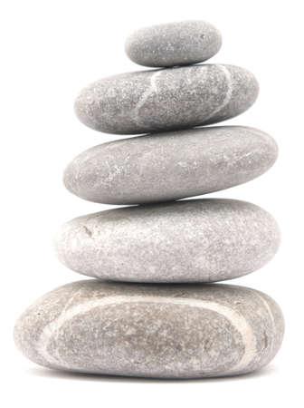 balancing stone tower isolated on white background Imagens