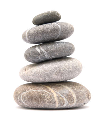 balancing stone tower isolated on white background 免版税图像