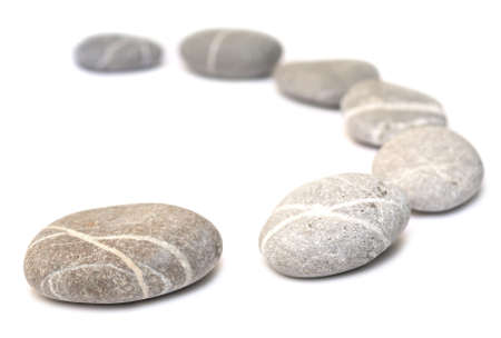 row of pebbles isolated on white background