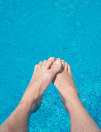 male legs in the pool water Stock Photo