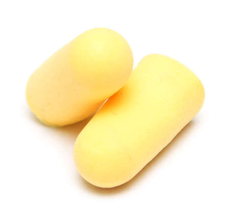 two yellow earplugs isolated on white background