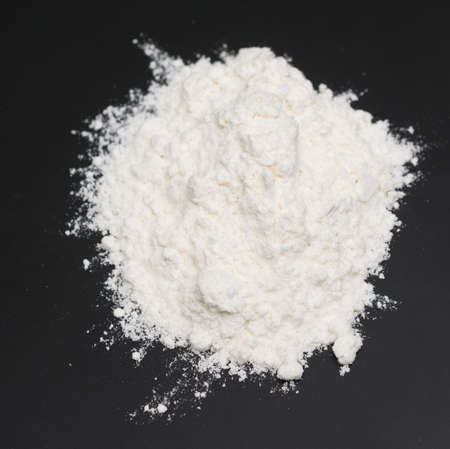 wheat flour on black background Stock Photo