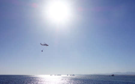 helicopter over sea