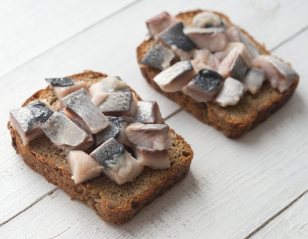 Two open sandwiches with herring