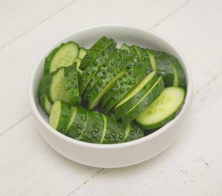 Cucumber salad on a wooden table Foto de archivo - 124172934