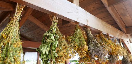 Hanging bunches of herbs and flowers Archivio Fotografico - 129263843