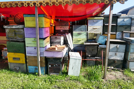 Stack of wooden colorful hives