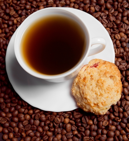 sweet shop:  Coffee in white cup with cookies, beans Stock Photo