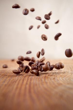 Flying coffee beans on abstract background