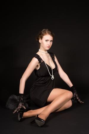 film noir: film noir girl in the retro image of a black background