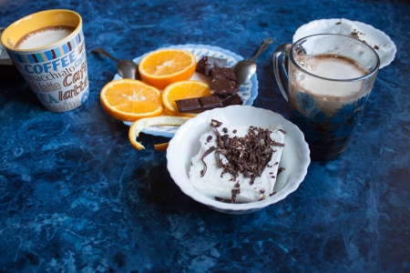 Coffee mug, ice cream and orange photo