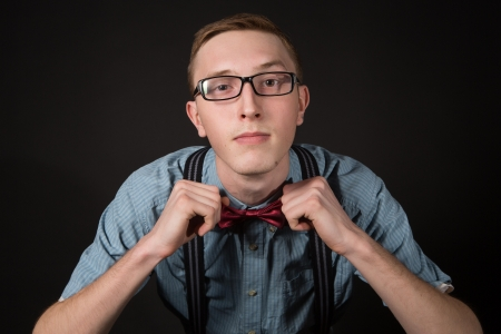 man in red  bow tie plaid shirt photo