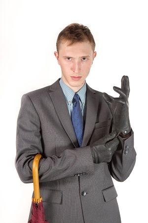 man in a gray jacket wear gloves on a white background Stock Photo