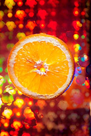 Orange  with many water drops on the abstract background