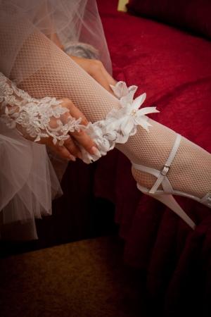Close-up of bridal garter on leg