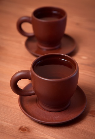 chinese tea ceremony: Clay teapot and cups on a wooden table