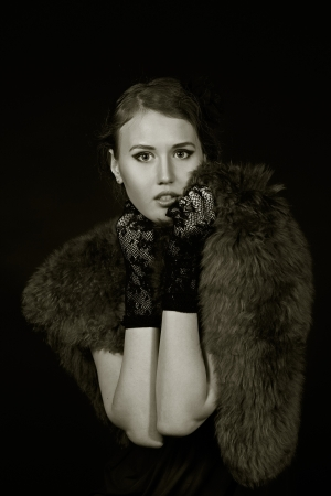film noir girl in the retro image of a black background black and white picture Stock Photo