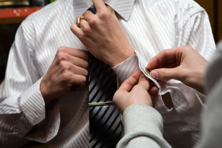 suit  cuff: a man in wedding suit preparing his look
