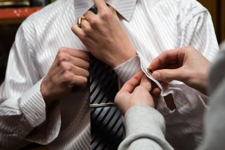 a man in wedding suit preparing his look