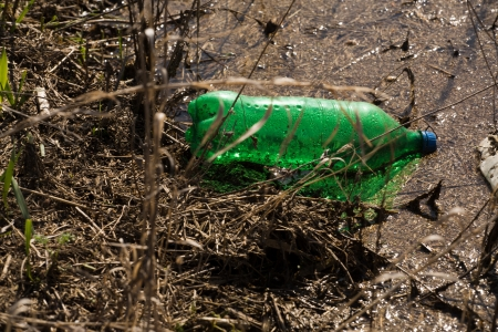 Bottles and trash in the river photo