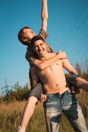 gay men: Portrait of a happy gay couple outdoors