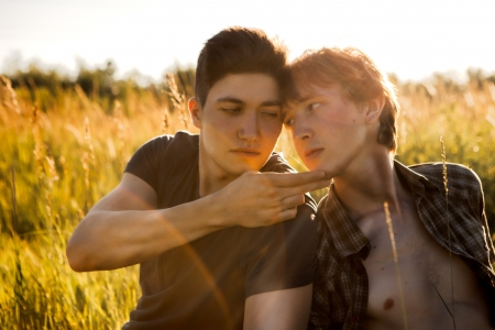 gay lifestyles: Happy Young Gay Couple Outside Stock Photo
