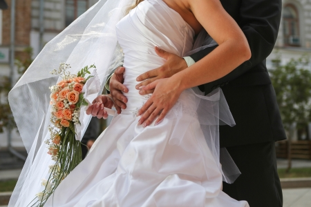 Bride with groom holding wedding bouquet at ceremony Stock Photo