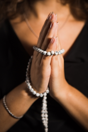 Young female prayer with rosary Stock Photo - 21276062