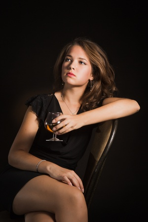 beautiful girl with glass of wine photo