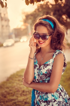 American redhead girl in suglasses  Photo in 60s style  Stock Photo - 21670578