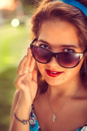American redhead girl in suglasses  Photo in 60s style Stock Photo - 21670609