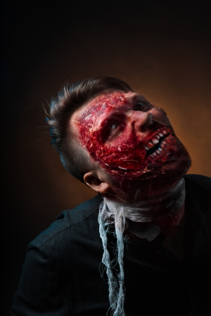 madman: portrait of scary bad zombie at night Stock Photo
