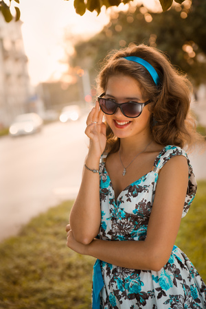 American redhead girl in suglasses. Photo in 60s style. Stock Photo - 22469658