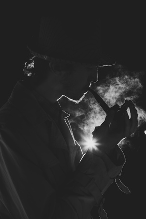 Black and white old-fashioned portrait of man with cigar photo