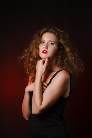 mysterious sexy girl with red lips photo