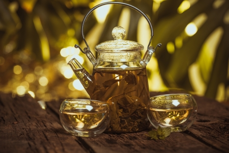 Hot glass of tea on wood table photo