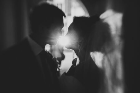 night suit: silhouette of a young bride and groom