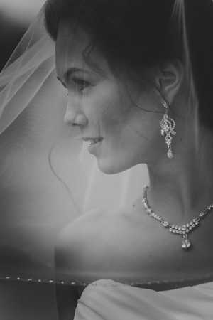 Black and white portrait of a Beautiful Bride Close up glowing from the sun light