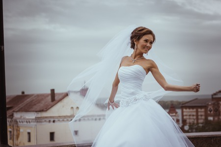 happy bride in white dress
